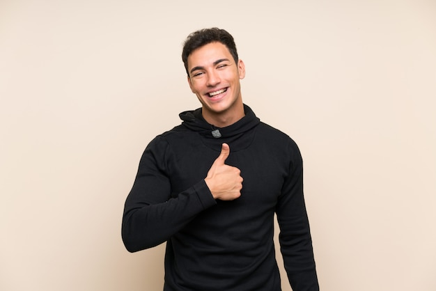 Handsome man giving a thumbs up gesture