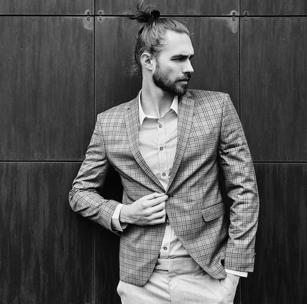 Handsome man in gray checkered suit in black and white