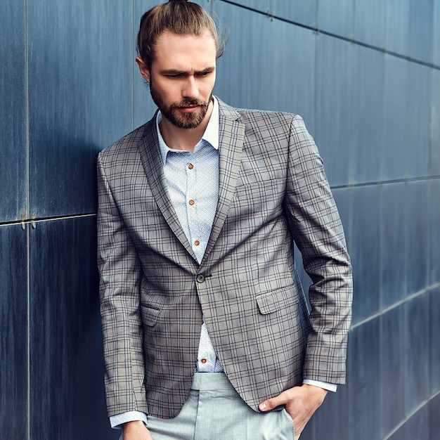 Handsome man in gray checkered suit