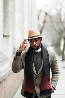 Handsome man in grey jacket walking