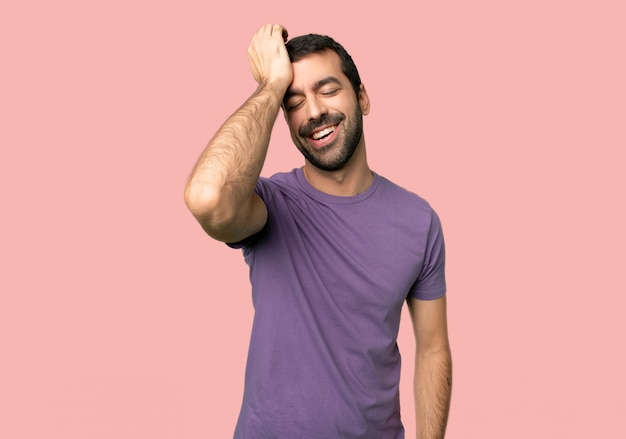 Handsome man has just realized something and has intending the solution on isolated pink background