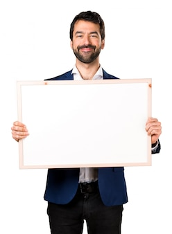 Handsome man holding an empty placard