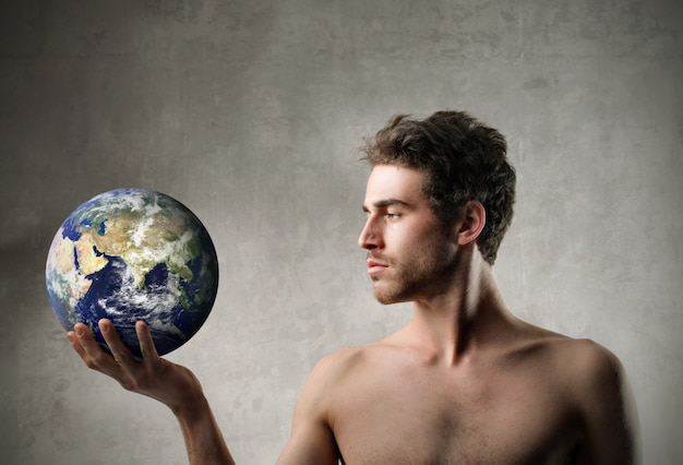 Handsome man holding the globe