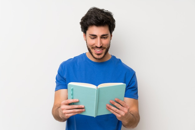 Handsome man holding and reading a book