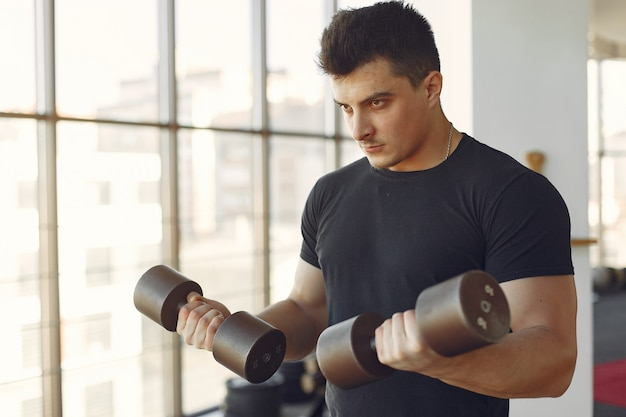 A handsome man is engaged in a gym