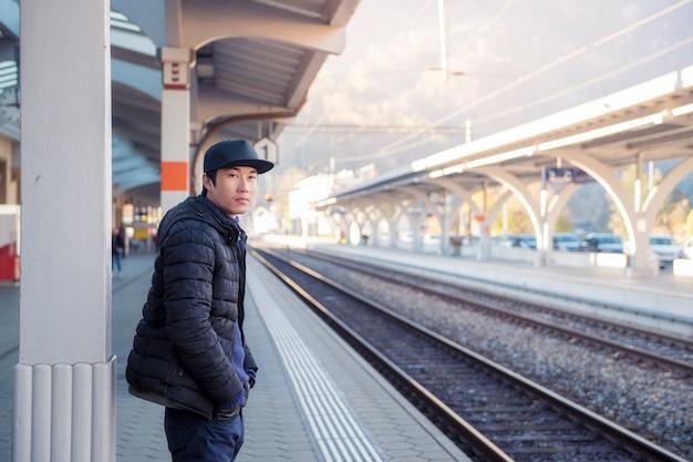 Handsome man is waiting switzerland rail