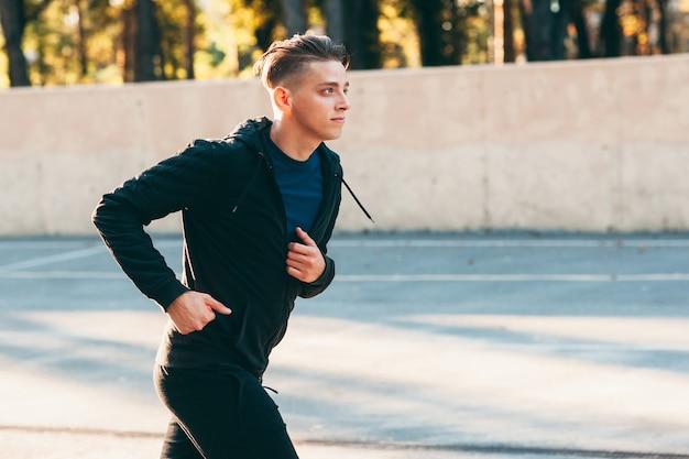 Handsome man jogging alone training for marathon