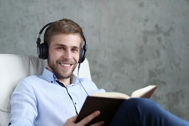 Handsome man listening music on headphones