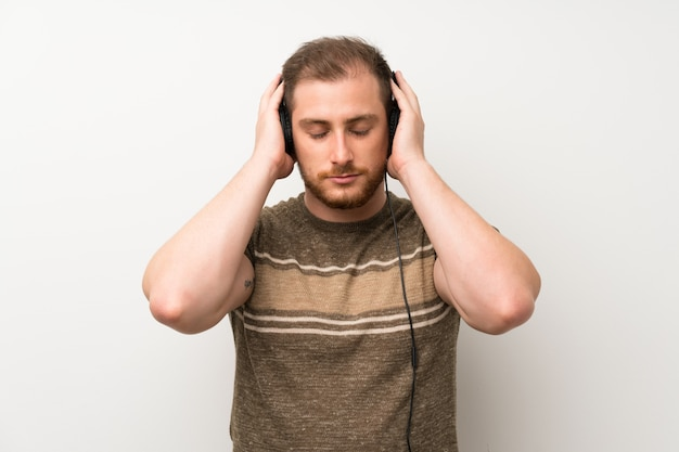 Handsome man listening to music with headphones