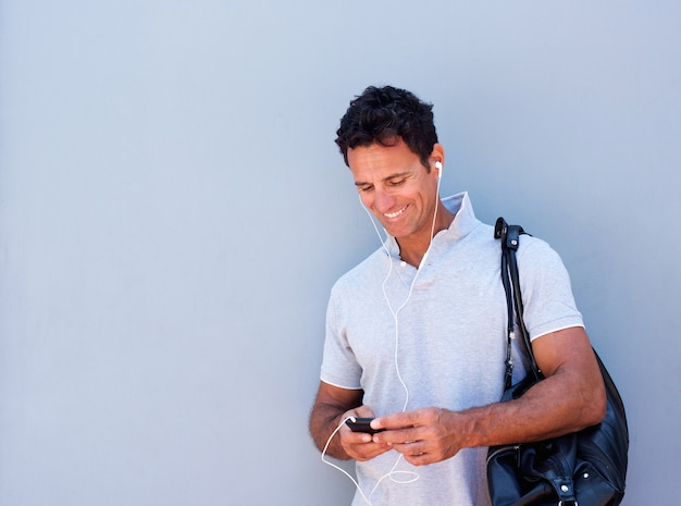 Handsome man listening to music with mobile phone