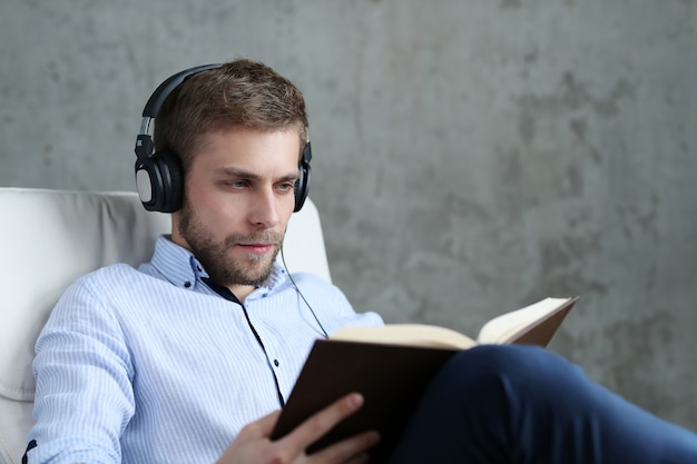 Handsome man listening podcast on headphones