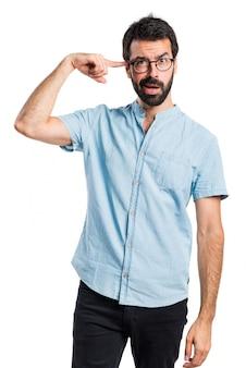Красивый мужчина делает сумасшедший жест Бесплатные Фотографии