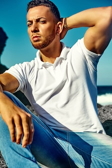 Handsome man model in hipster summer clothes