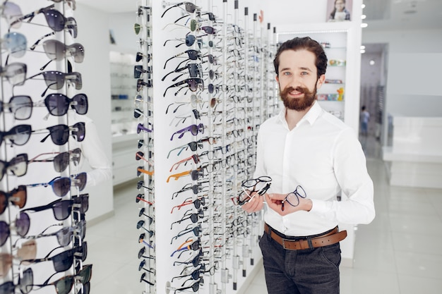 Handsome man in a optics shop