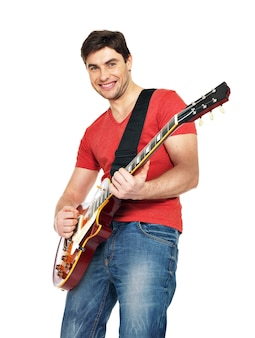 A handsome man plays on electric guitar with bright emotions, isolate on white