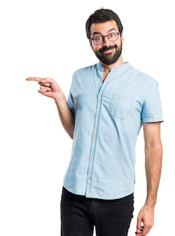 Handsome man pointing to the lateral