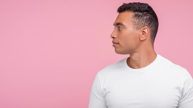 Handsome man posing from profile with copy space