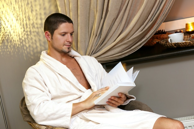 Handsome man reading a book