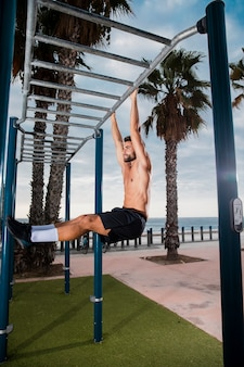 Handsome man set of exercises oudoors