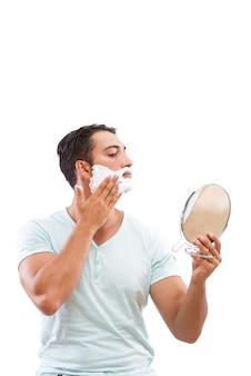 Handsome man shaving isolated on white