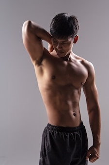 The handsome man show body muscle