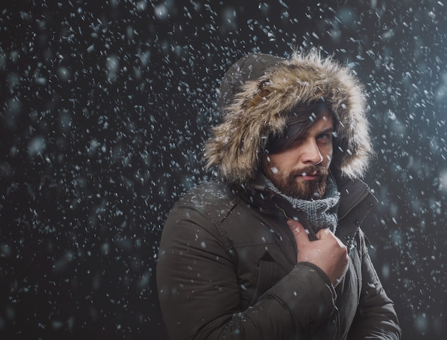Handsome man in snow storm