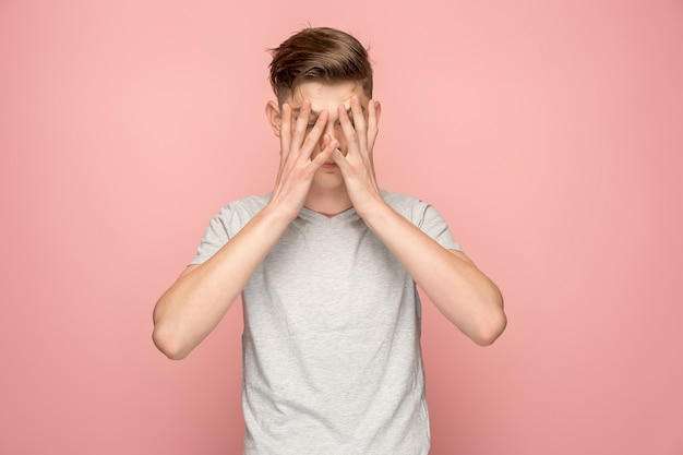 Handsome man in stress isolated on pink