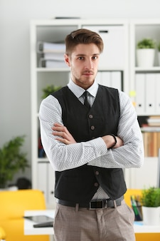 Handsome man in suit and tie stand in office