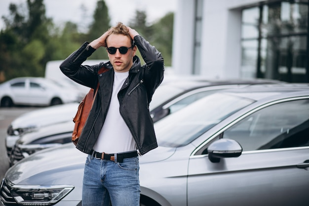 Handsome man tourist buying a car