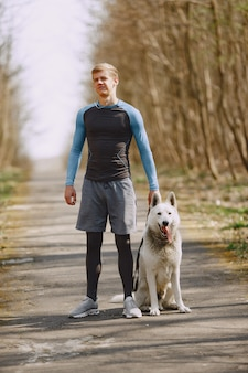 Handsome man training in a summer forest