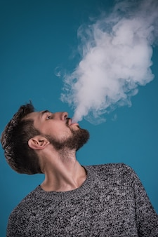 Handsome man vaping