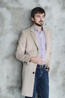 Handsome man wearing beige coat