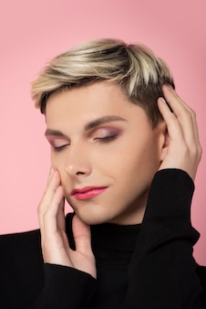 Handsome man wearing make-up