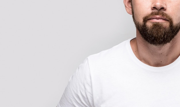 Handsome man in white t-shirt with copy space