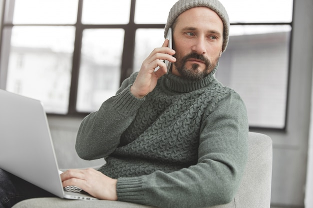 Handsome man with beard and laptop