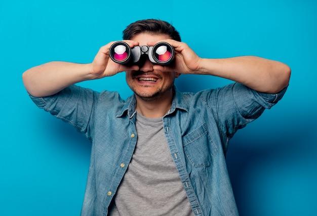 Handsome man with binoculars