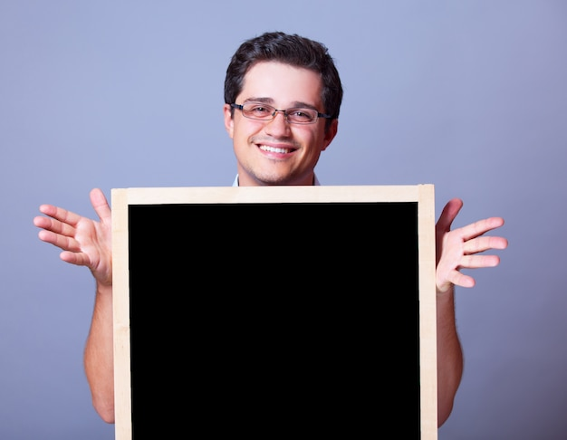 Handsome man with blackboard.
