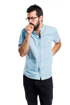Handsome man with blue glasses coughing a lot