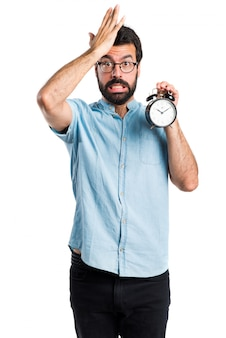 Handsome man with blue glasses holding clock