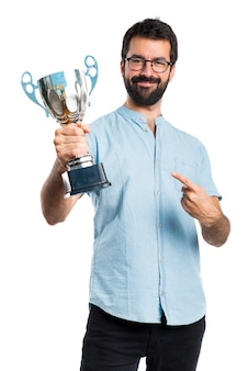 Handsome man with blue glasses holding a trophy