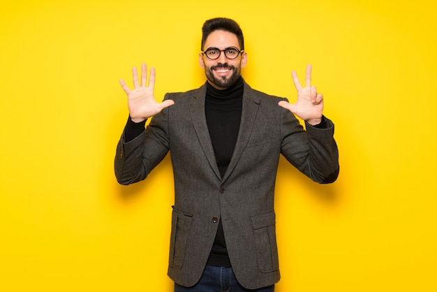 Handsome man with glasses counting eight with fingers