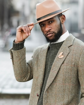 Handsome man with hat posing