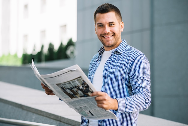 Handsome man with newspaper