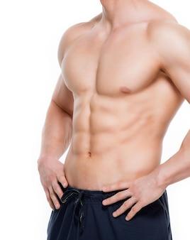 완벽 한 근육 질의 몸통-흰 벽에 고립 된 잘 생긴 남자.