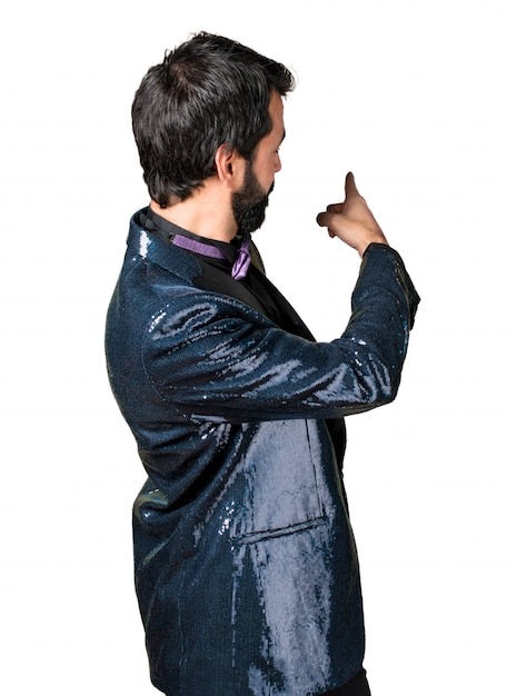 05a7a3be9fd9ec Handsome man with sequin jacket pointing back