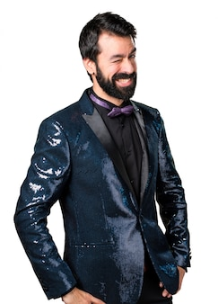 Handsome man with sequin jacket winking