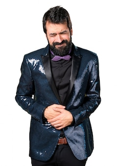 Handsome man with sequin jacket with stomachache