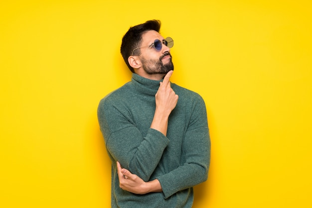 Handsome man over yellow background
