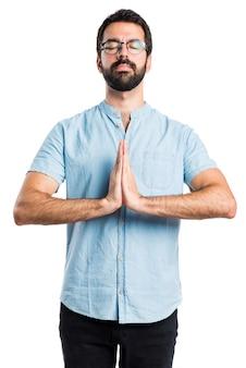 Handsome man in zen position