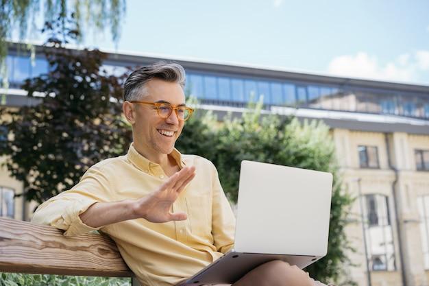Handsome mature businessman having video conference. blogger streaming video online